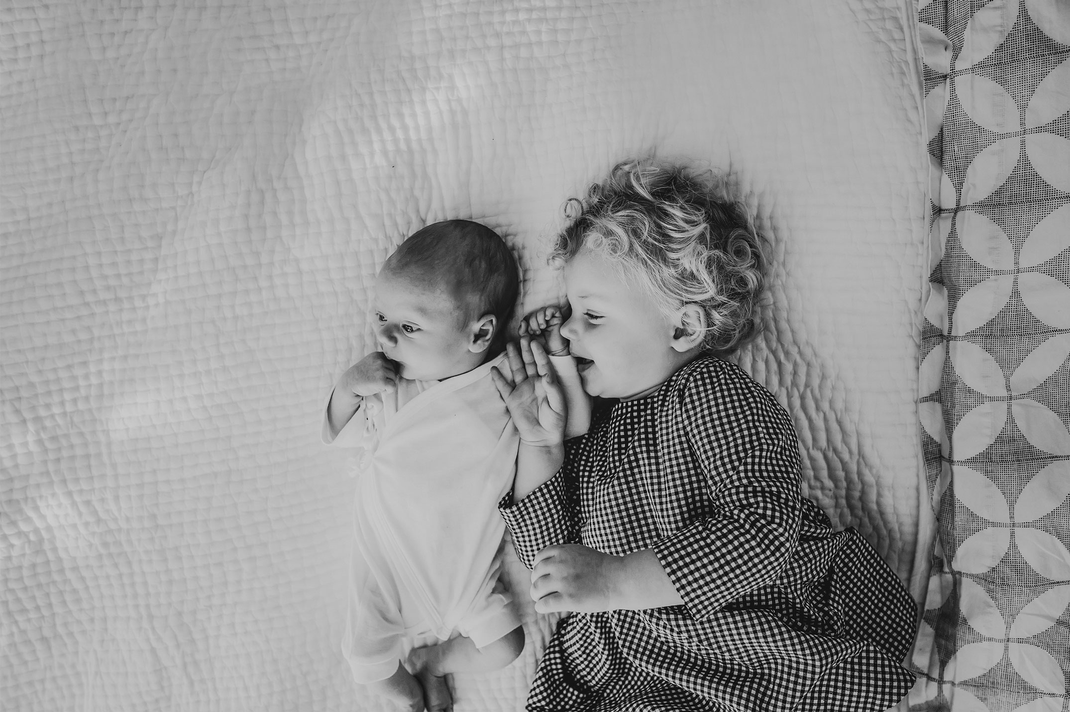 new siblings snuggle at newborn session in seattle