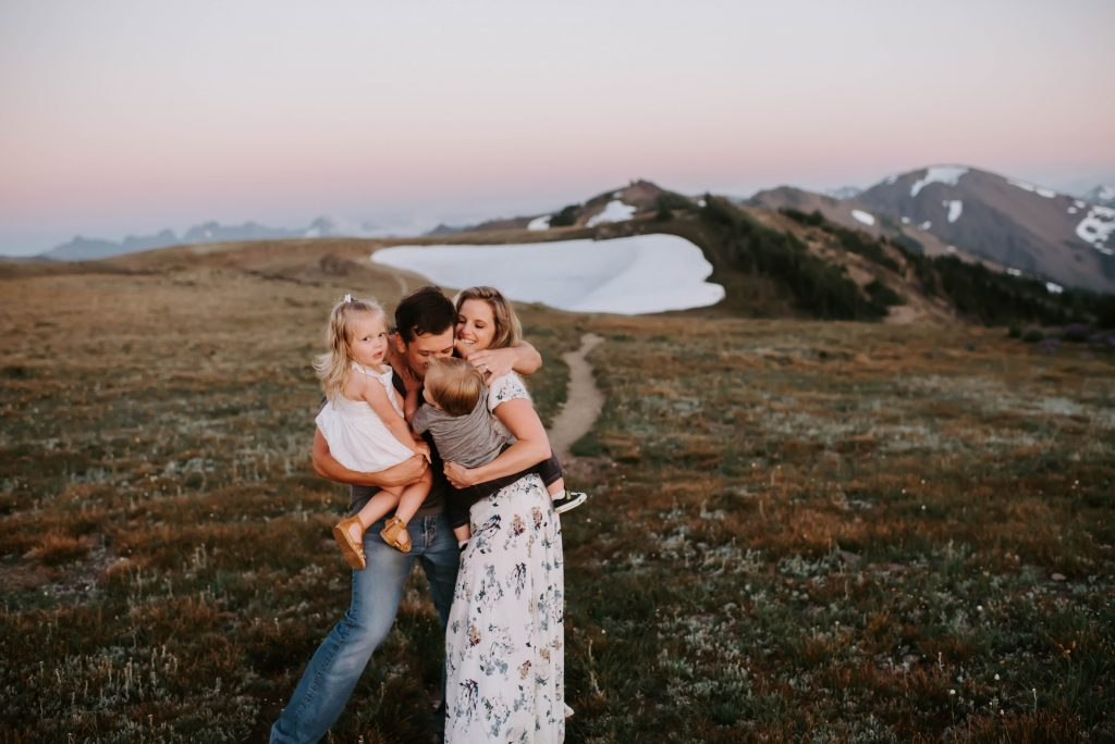 family snuggles on mountaintop portrait Seattle family photographer